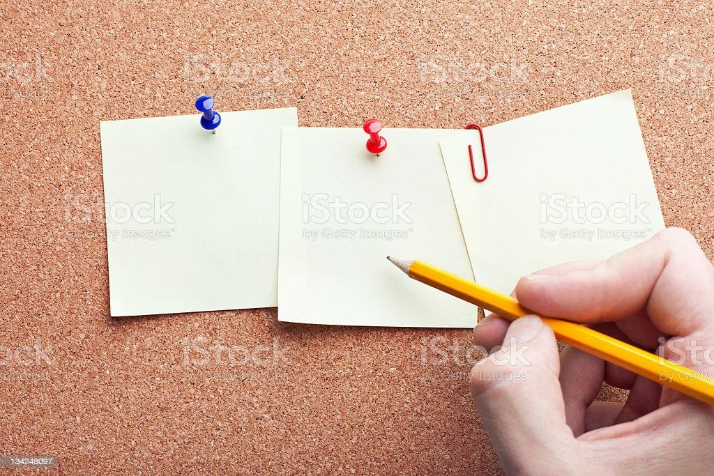 human hand writing with pencil on three note papers royalty-free stock photo