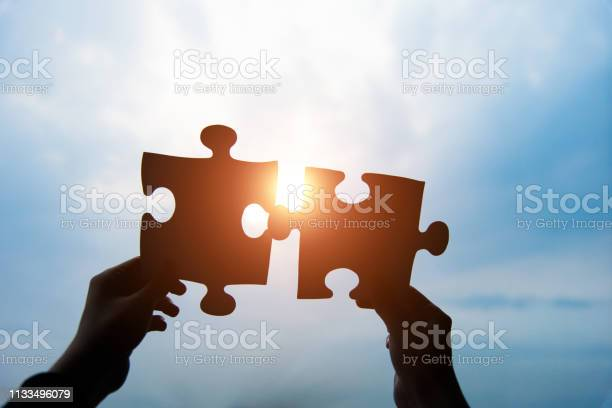 Human hands connecting two jigsaw puzzle pieces against cloudy sky picture id1133496079?b=1&k=6&m=1133496079&s=612x612&h=ox99hltpdenvyqx6vbbo3fspynfrqrh pxp tp2gcnw=