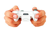 istock Human hands holding a wireless gaming controller on white background 182173911