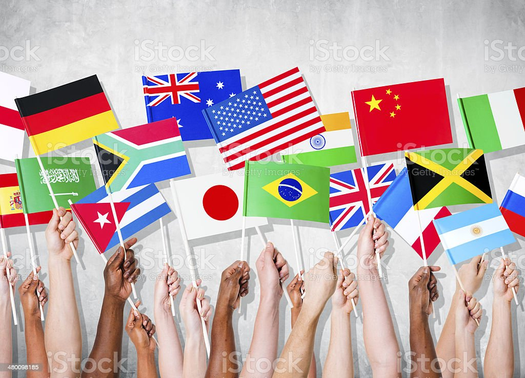 Human Hands Holding National Flags stock photo