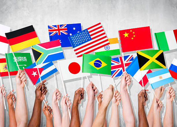 Human Hands Holding National Flags  global village stock pictures, royalty-free photos & images