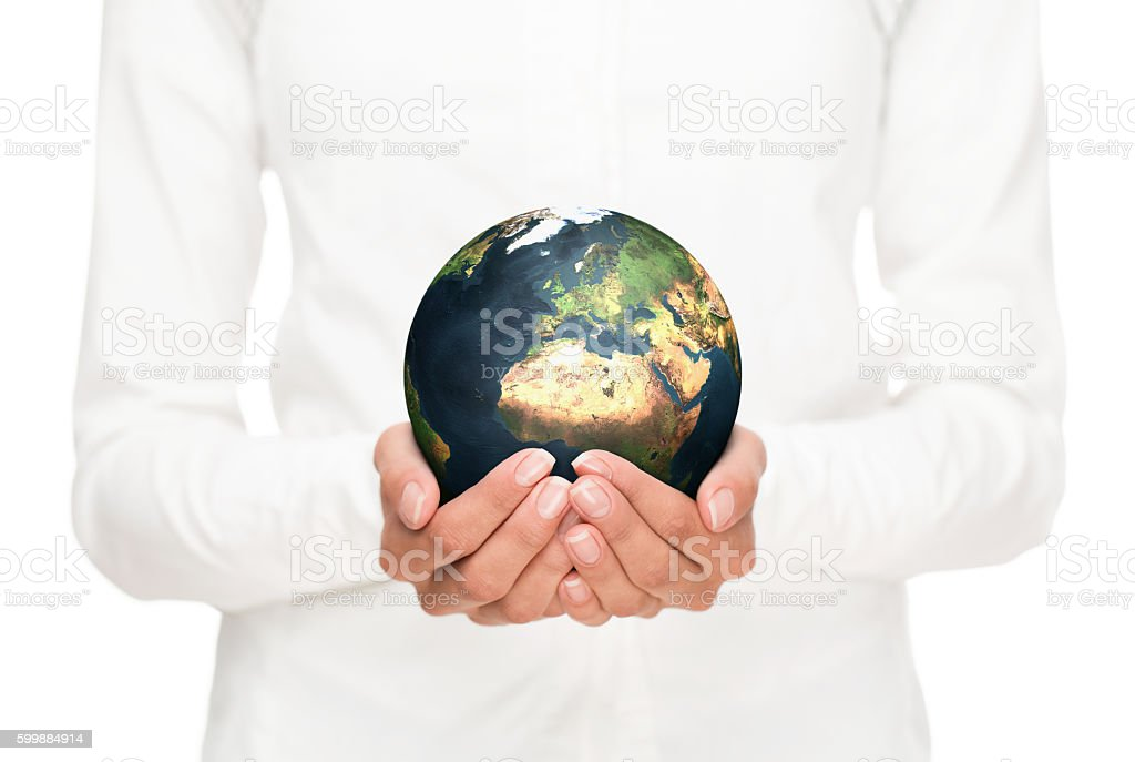Human hands holding planet earth stock photo