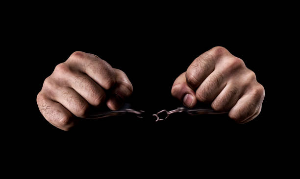 human hands in handcuffs and torn chains - boy handcuffs stock pictures, royalty-free photos & images