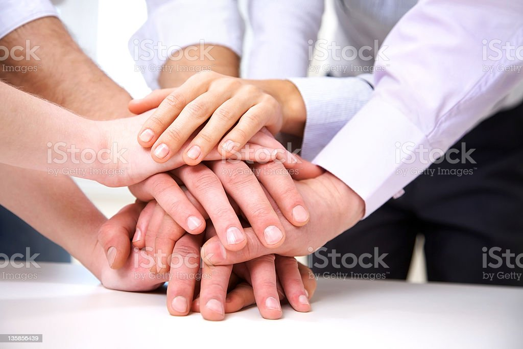 human hands in teamwork stock photo