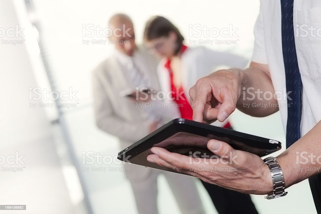 Human hands on digital tablet royalty-free stock photo