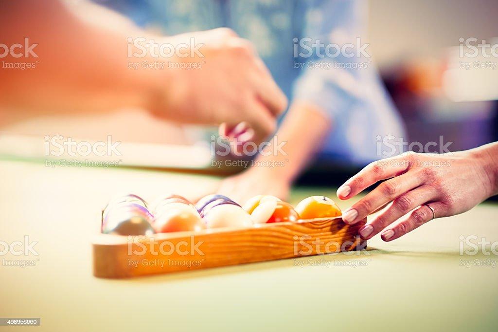 Human hands putdown billiards balls on table stock photo