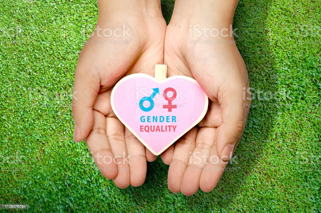 Human hands showing heart shape with gender equality sign. Equality...
