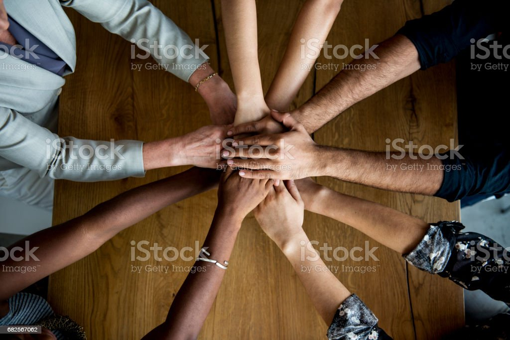 Human hands together holding together stock photo