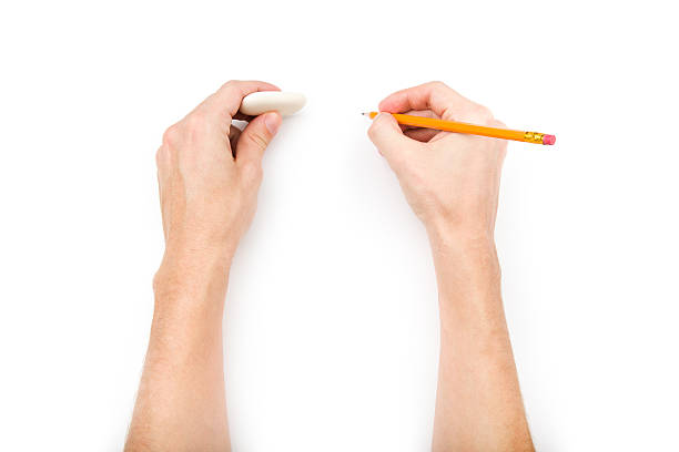 Human hands with pencil and eraser stock photo