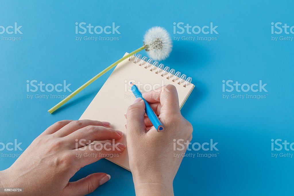 Human hands with pencil writing on paper royalty-free stock photo