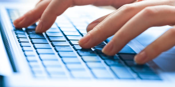 Human hands working on laptop Human hands working on laptop computer keyboard stock pictures, royalty-free photos & images