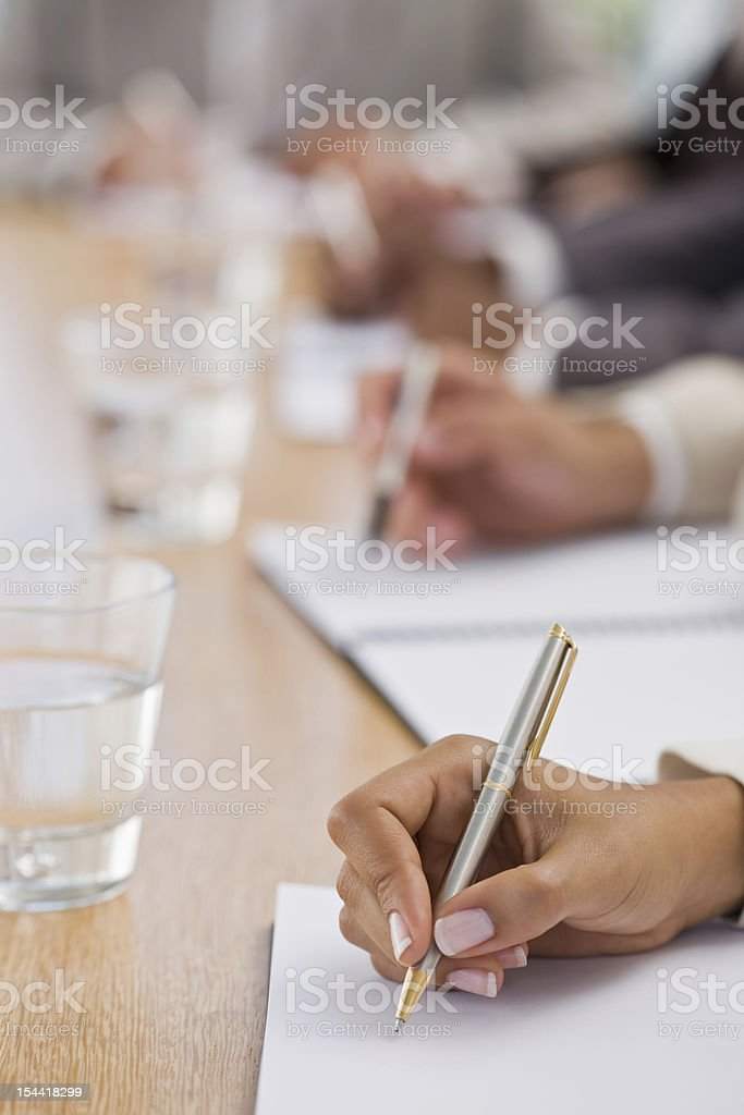 Human hands writing on notebook royalty-free stock photo