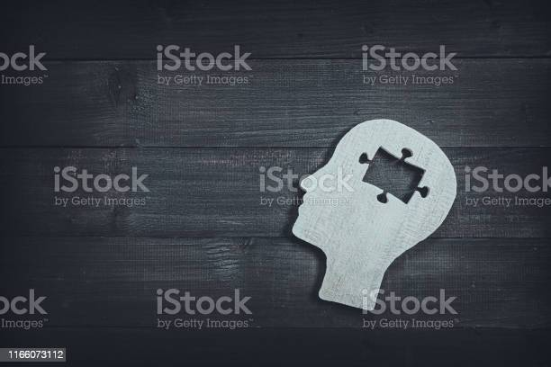 Human head and face with puzzle sign on wood table background brain picture id1166073112?b=1&k=6&m=1166073112&s=612x612&h=6yjhcmyf4hdahvpnsv5bbtdpl ecxofbx16fb4apue0=