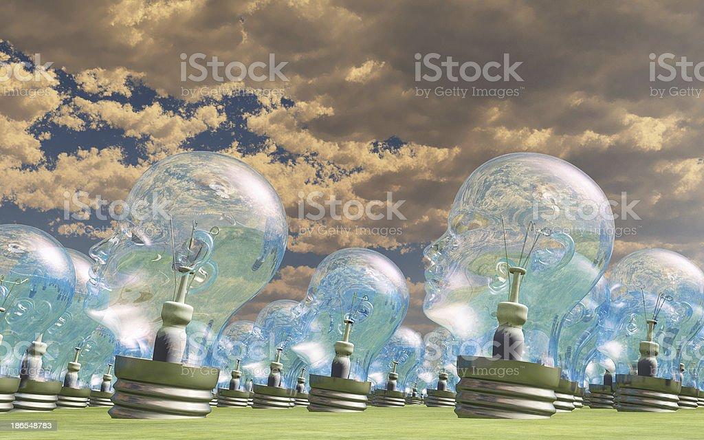 Human head lightbulbs in landscape royalty-free stock photo