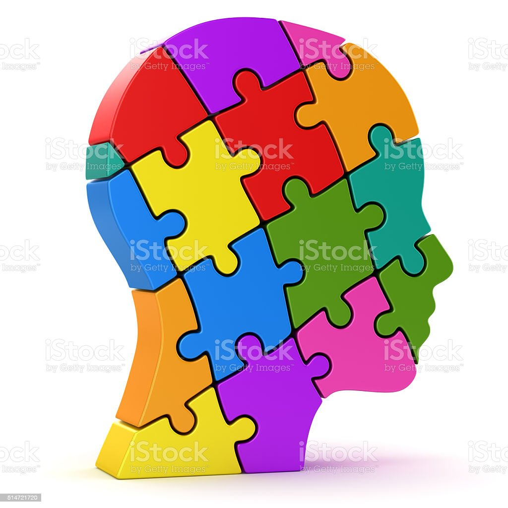 Human head made of colorful puzzle pieces stock photo