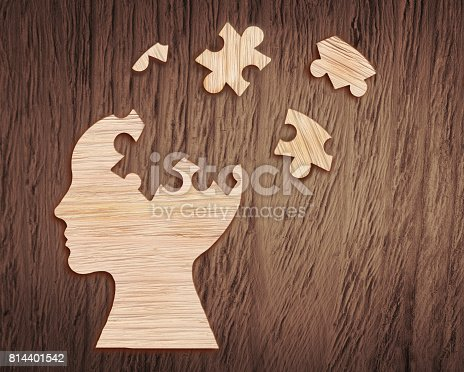 istock Human head silhouette with a jigsaw piece cut out 814401542