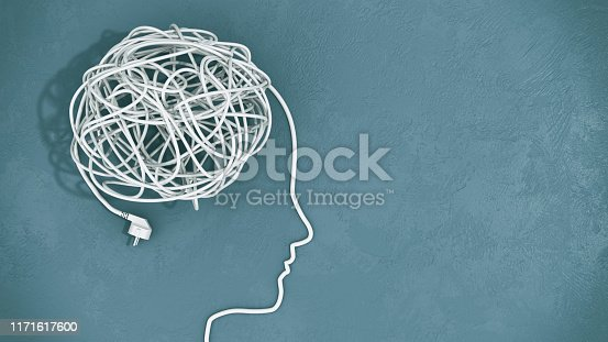 Tangled cables in a silhouette of the human head