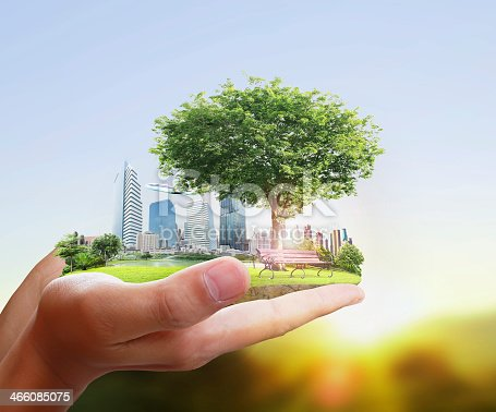 istock Human holding a city in their hands 466085075