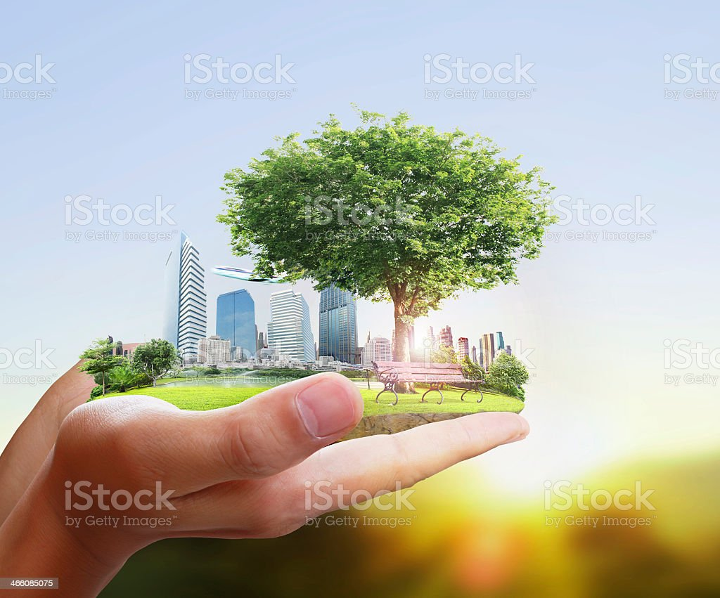 Human holding a city in their hands stock photo