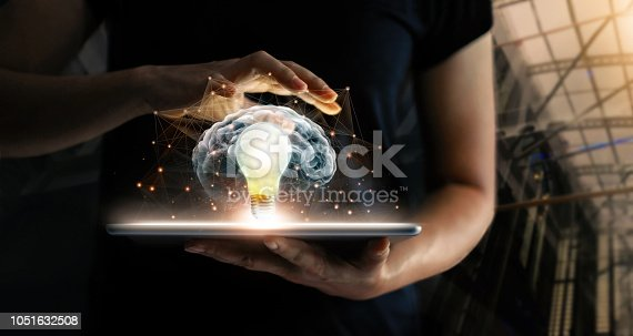 istock Human holding tablet with light bulb future technology, brain and network connection communication background, science, innovation and creative idea concept. 1051632508