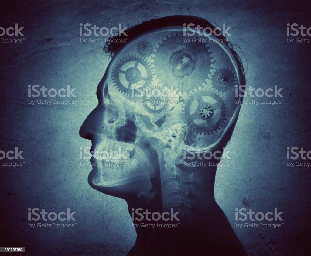 Human intelligence made of cogs and gears on the grunge texture. stock photo