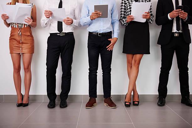 human legs of people which waiting for job interview - outfit vorstellungsgespräch stock-fotos und bilder