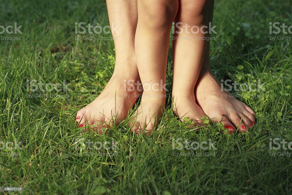 Human legs on the grass royalty-free stock photo