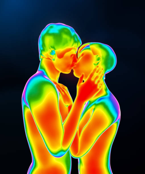 Human male and female loving couple kissing chemistry. Body thermic activity 3d rendering illustration. Infrared or thermal effect. Science, biology, medical, physiology, love, sexuality concepts. stock photo