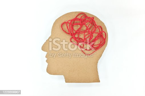 Human male head profile silhouette  with tangled red yarn as brain gear. Mental health depression, confusion and overthinking concept.