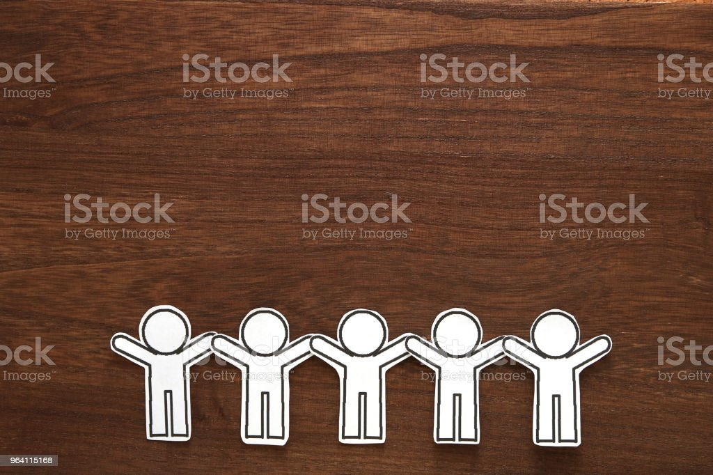 Human paper cut illustration vector on brown wood.  Teamwork concept. Social Network concept. stock photo