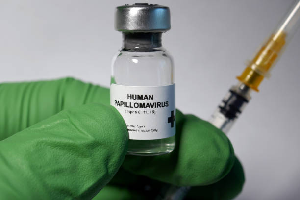 Human papilloma virus inoculation Human papillomavirus vaccine - administration of antigenic material (vaccine) to stimulate an individual's immune system to develop adaptive immunity to a pathogen. human papilloma virus stock pictures, royalty-free photos & images