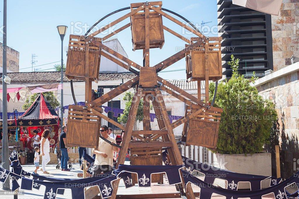 Human powered wooden ferris wheel stock photo