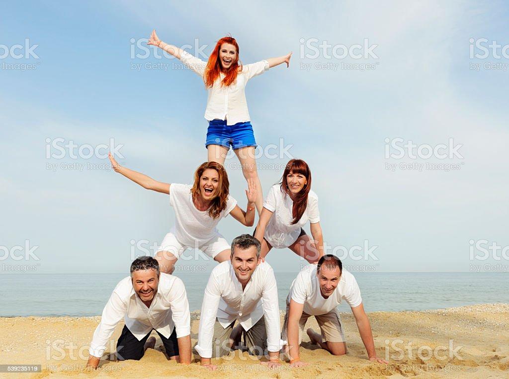 human pyramid on beach royalty-free stock photo