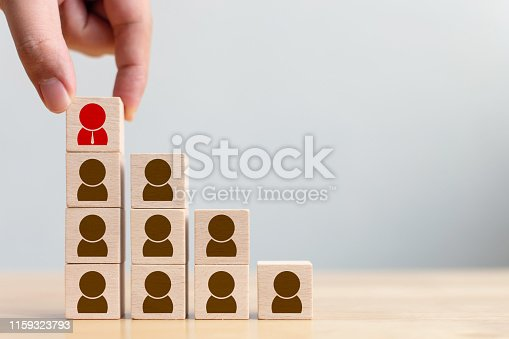 istock Human resource and talent management and recruitment business concept, Hand putting wood cube block on top staircase 1159323793