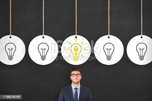 493338692istockphoto Human Resource Concepts over Business Person Head on Chalkboard Background 1159245181