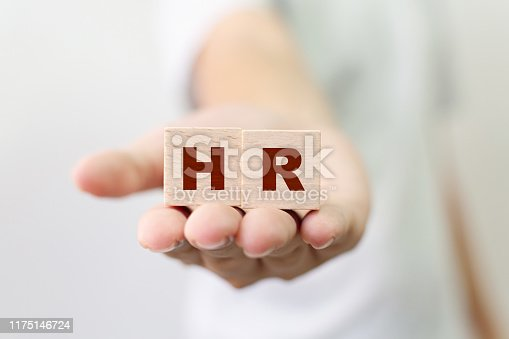 641422198istockphoto Human resource management and recruitment business concept, Hand holding wooden cube block with word HR 1175146724