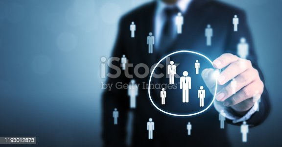 641422198istockphoto Human resource management and recruitment employment business concept. Businessman drawing circle select group people standing out of crowd 1193012873