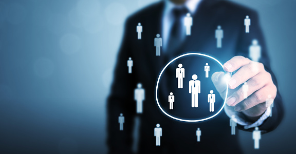 641422198 istock photo Human resource management and recruitment employment business concept. Businessman drawing circle select group people standing out of crowd 1193012873