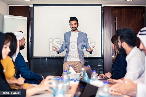 471250190istockphoto Human Resource Manager Leading a Staff Meeting 1054664476