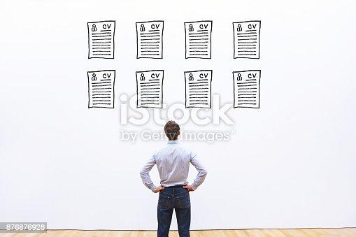 istock human resource manager looking at many cv resume 876876928