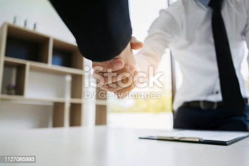 istock human resource recruiter handshaking with candidate 1127065993