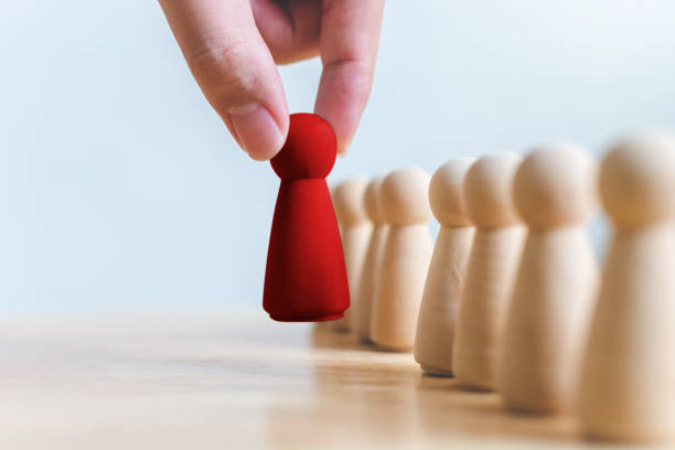 human resource, talent management, recruitment employee, successful business team leader concept. hand chooses a wooden people standing out from the crowd. - deaden stock pictures, royalty-free photos & images