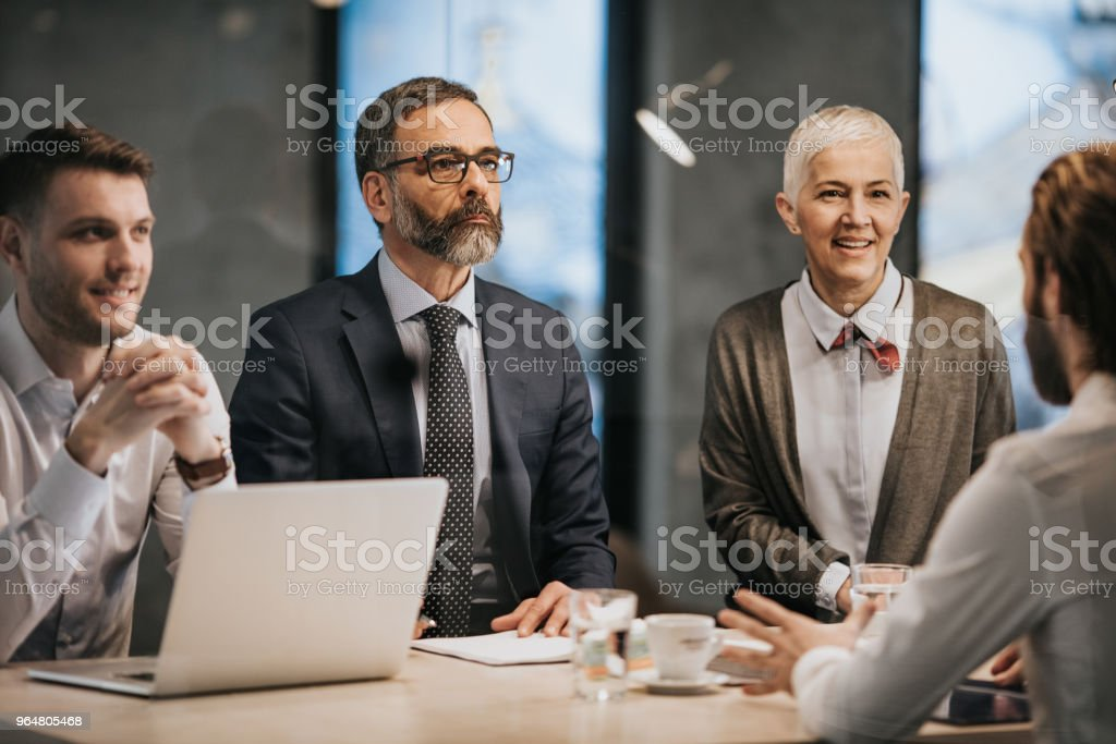 Human resource team listening to a candidate on a job interview in the office. royalty-free stock photo