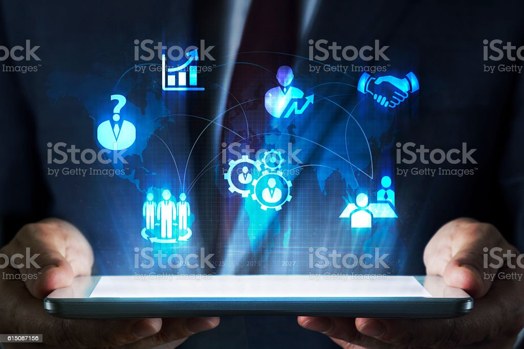 Human resources concept on tablet with hologram stock photo