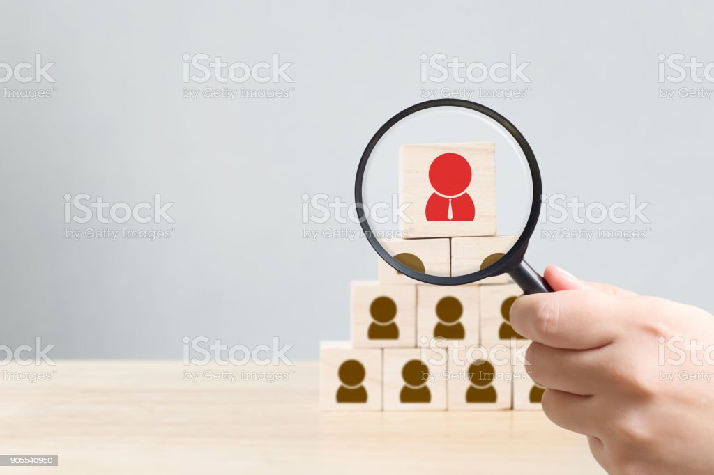 Human resources management and recruitment business hiring concept, Hand held magnifying glass, Copy space for your text stock photo