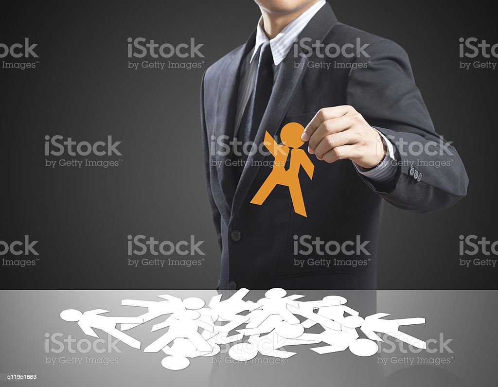 Human resources officer choose employee standing out of the crowd. stock photo
