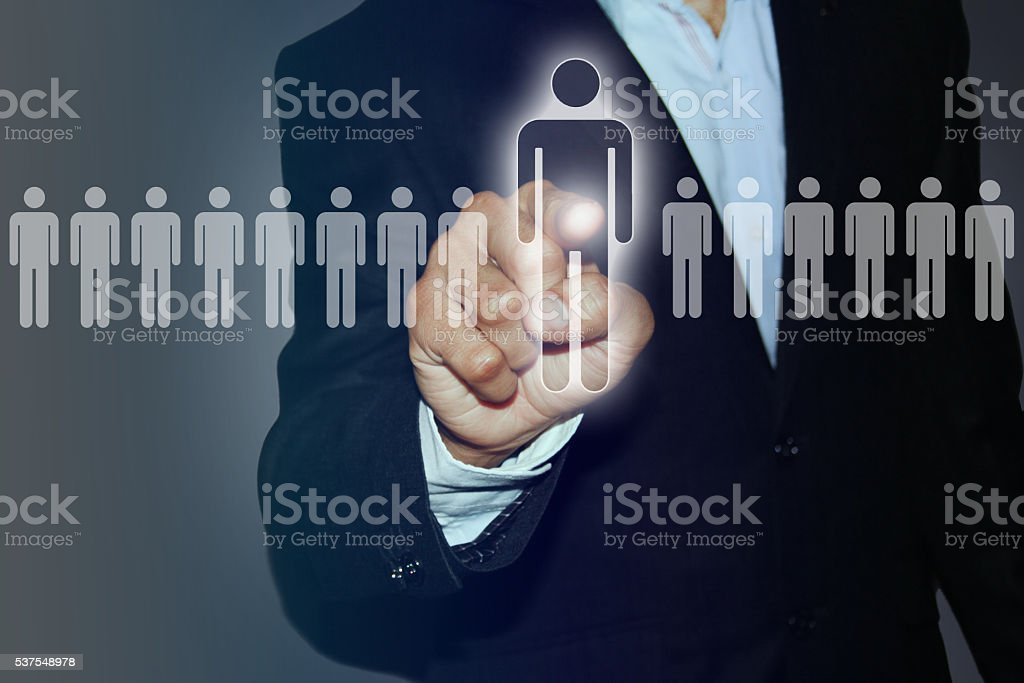Human resources officer choose employee standing out of the crowd stock photo