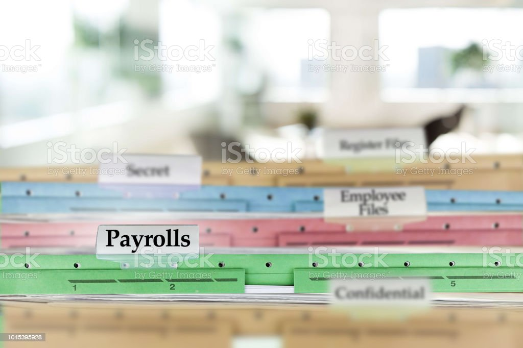 Human resources payroll files and other internal documents stock photo