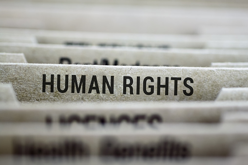 Human Rights label on file folder tab with shallow DOF and focus on label