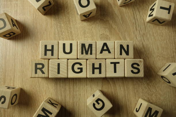 Human rights text from wooden blocks stock photo